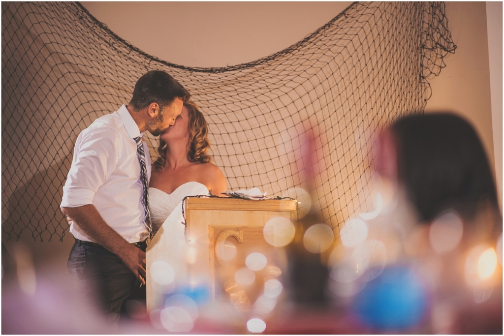 Bride and Groom Kissing during Speech