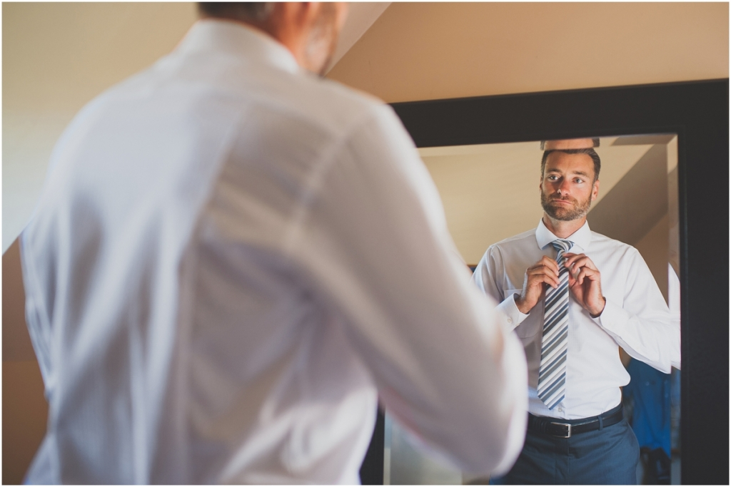 Dapper Groom getting ready on wedding day