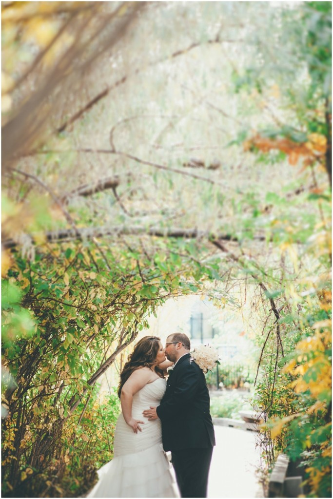 Summerland Wedding Couple kissing under arch
