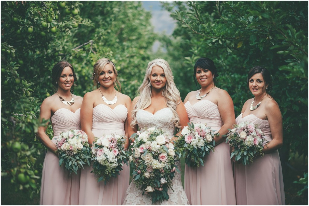 Stunning Bride with Bridesmaids in Orchard
