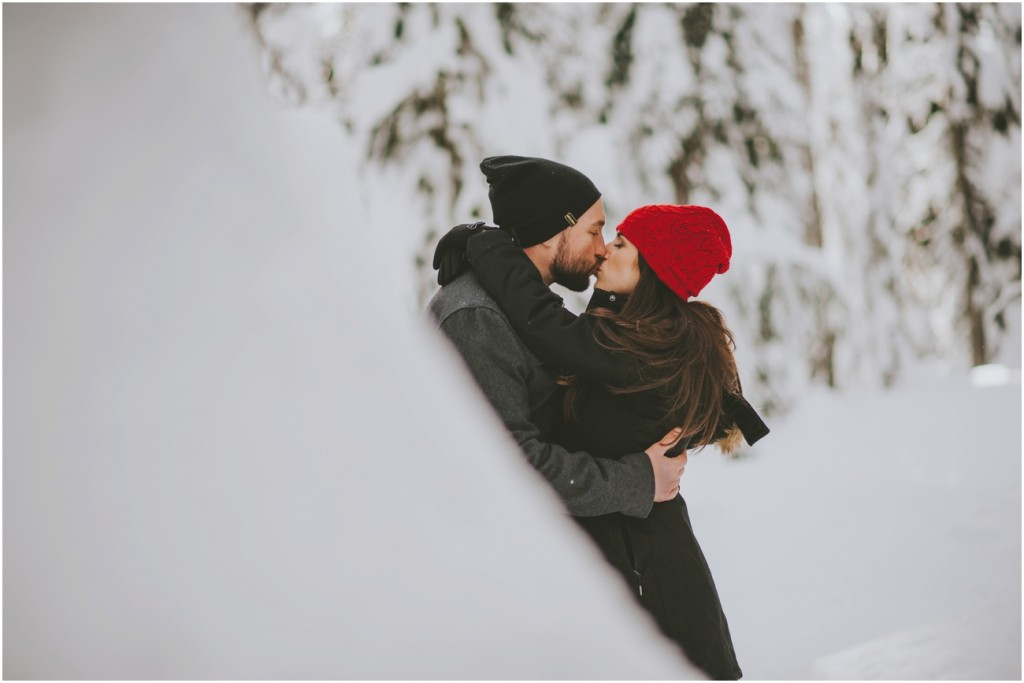 Kissing in snowy trees