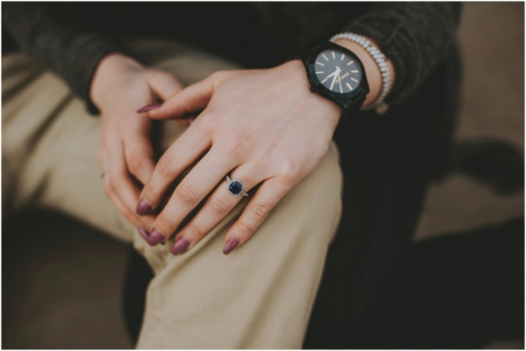 Engagement ring details with blacked out watch