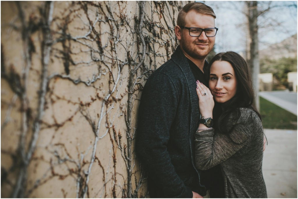 Wall filled with vines for engagement photo
