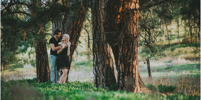 Darling couple in the trees during photoshoot