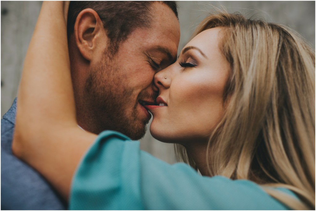 Intimate Couple kissing for engagement photos
