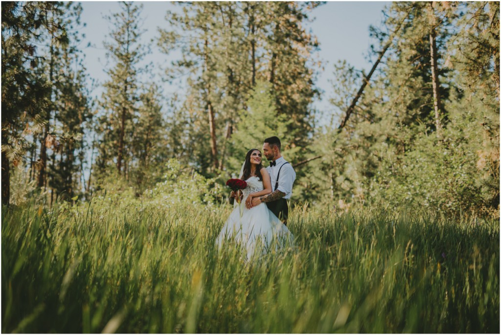 Darling wedding couple in lush field