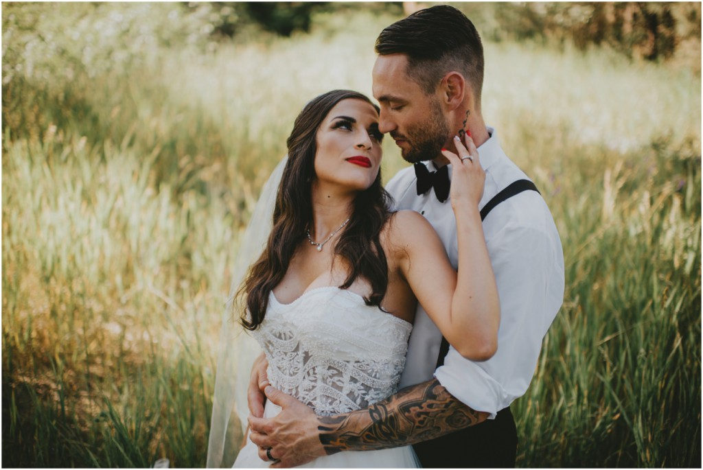 intimate wedding portrait in lush grass