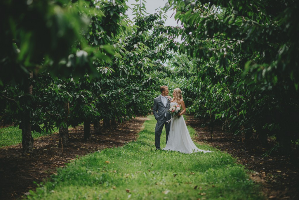Bride and groom portraits in Cherry Orchard