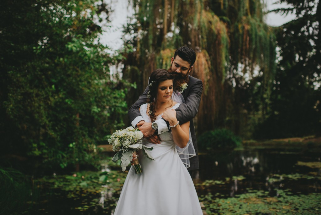 Wedding by pond surrounded by willow trees