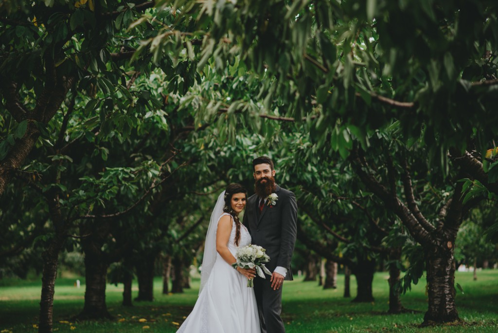 Bride and Groom in Orchard in Lake Country