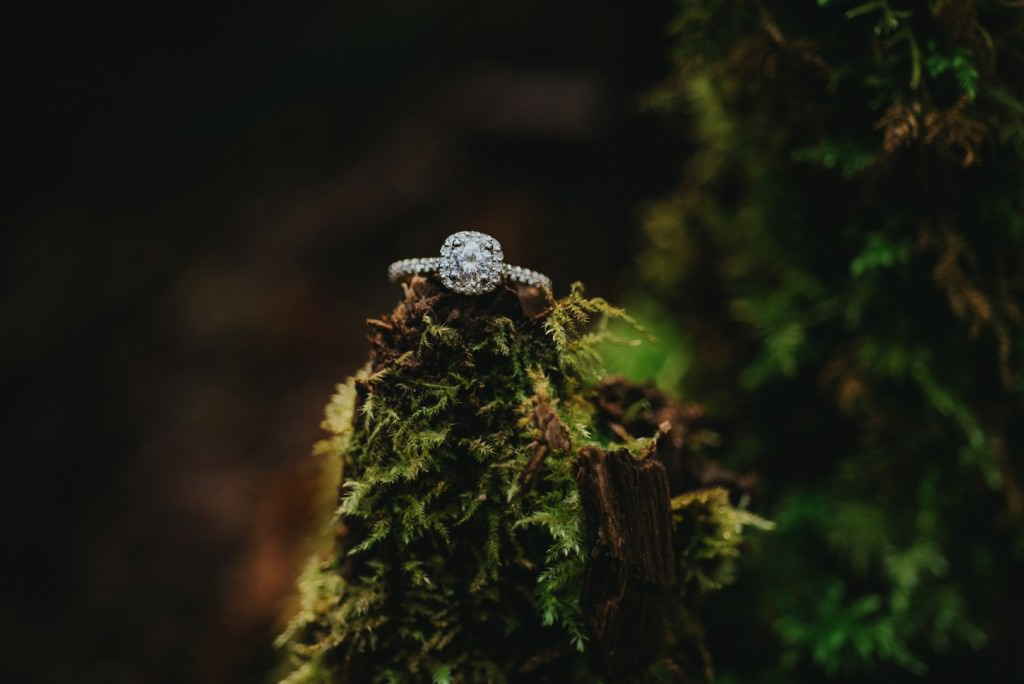 Wedding ring on forest moss